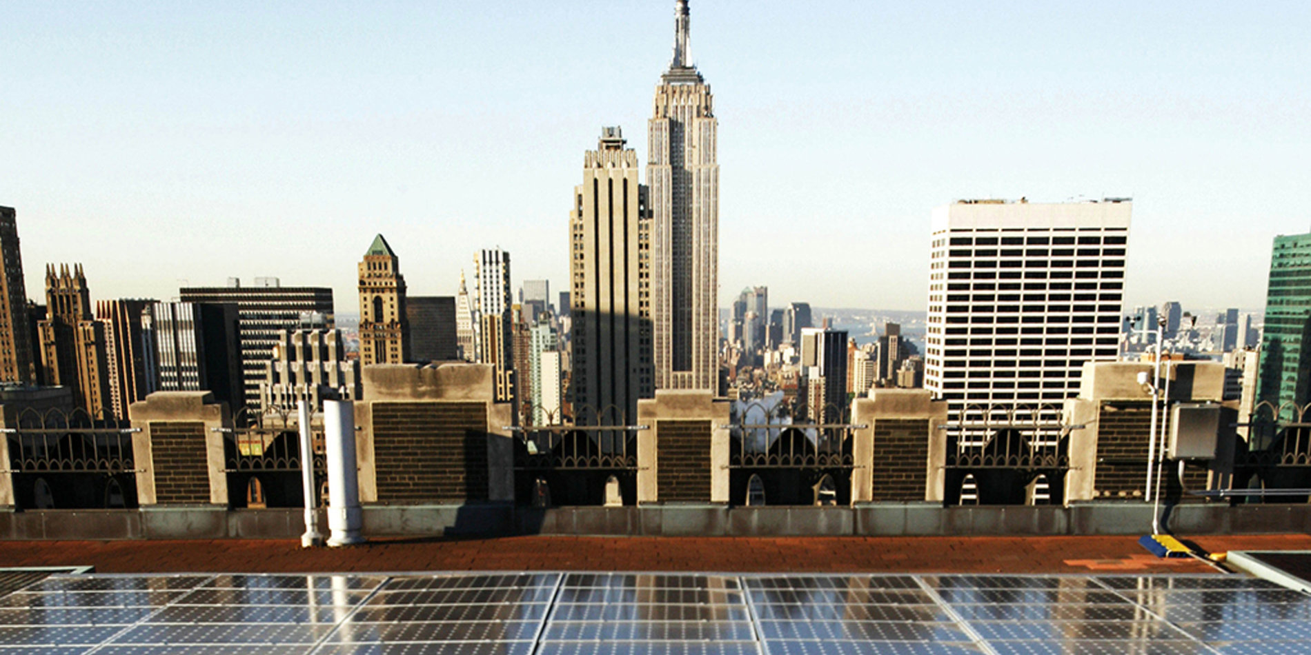 Image of solar panels and city view