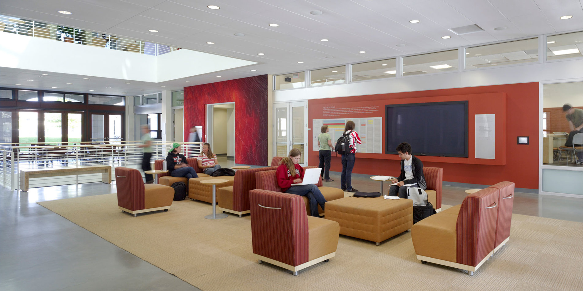 students sitting in the lobby area of the Y2E2 lobby